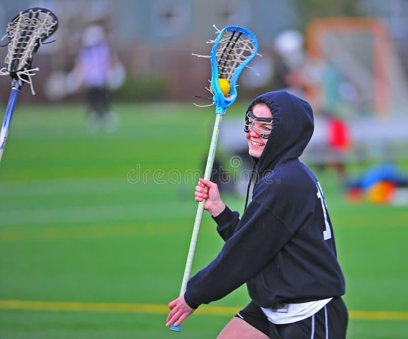 Sonrisa de la muchacha del lacrosse foto de archivo libre de regalías