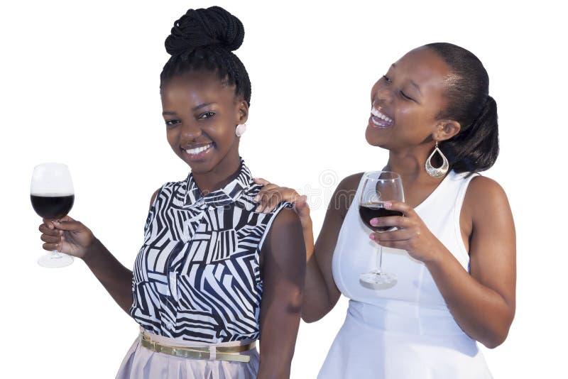 Sonrisa de la mujer de dos africanos foto de archivo