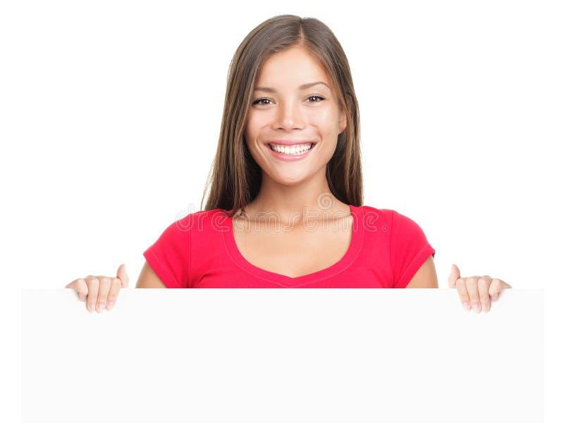 Sonrisa de la mujer de la muestra de la cartelera foto de archivo libre de regalías