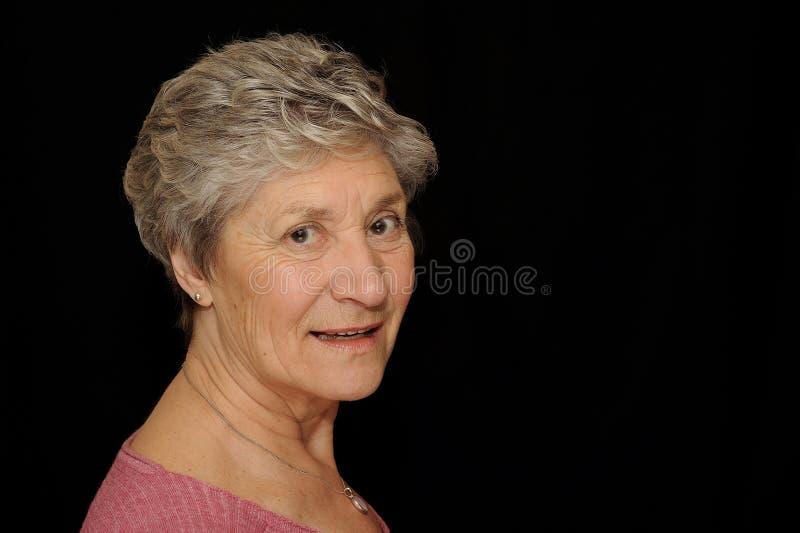 Sonrisa de la mujer mayor  fotografía de archivo