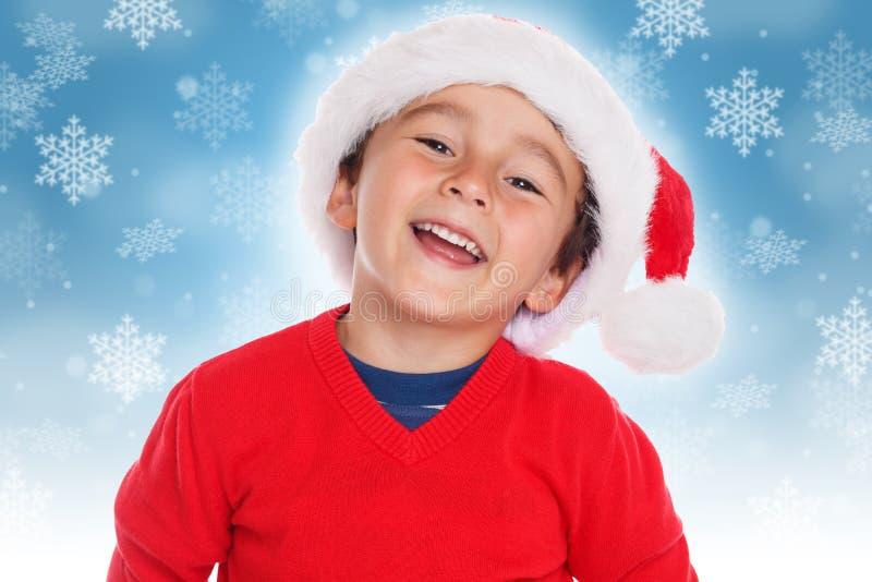 Sonrisa de Santa Claus de la Navidad del muchacho del niño del niño feliz fotografía de archivo