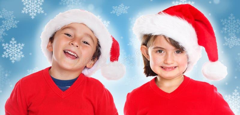 Sonrisa de Santa Claus de la Navidad de la muchacha del muchacho de los niños de los niños feliz imagen de archivo libre de regalías
