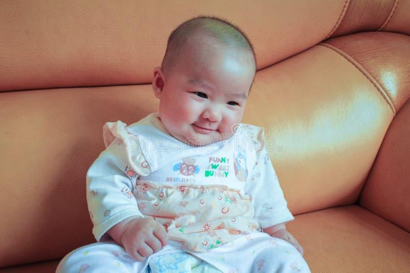 Sonrisa del bebé de los meses del Serval fotos de archivo libres de regalías