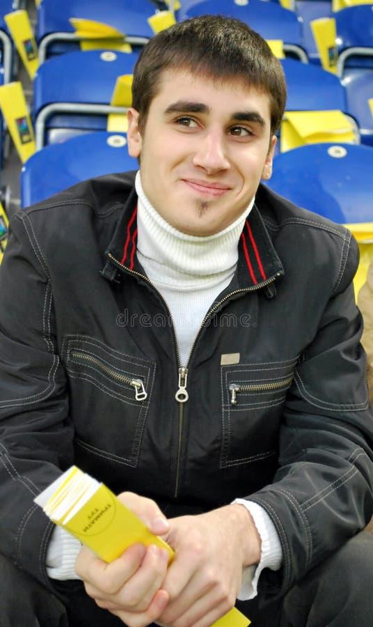 Sonrisa del fanático del fútbol imagen de archivo