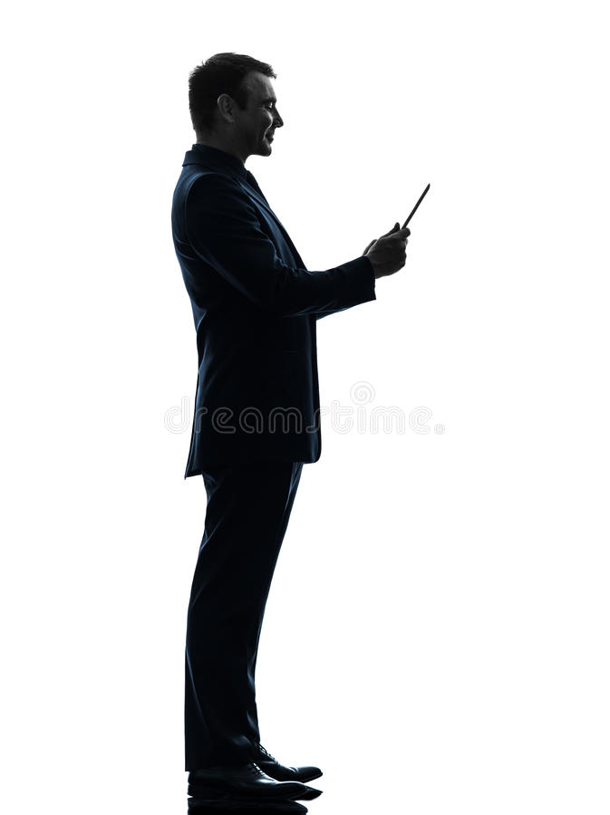 Sonrisa del hombre de negocios   silueta digital de la tableta fotos de archivo