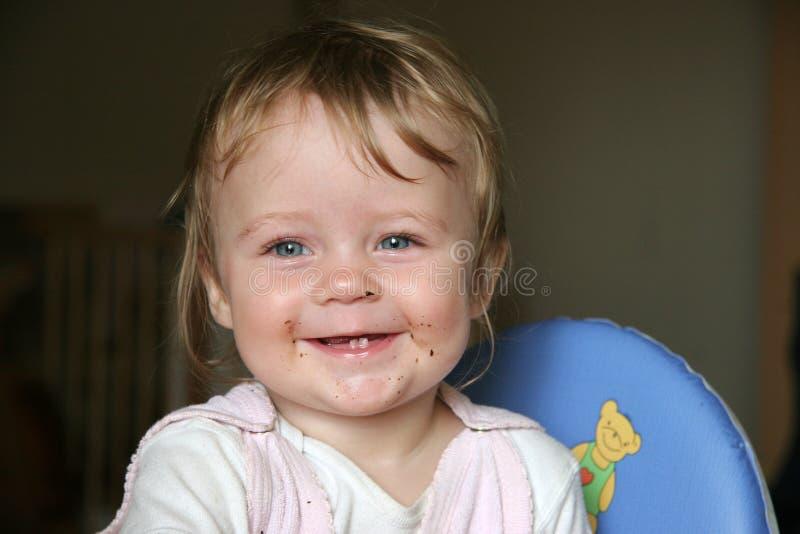 Sonrisa en cara del bebé del borrón de transferencia imagen de archivo