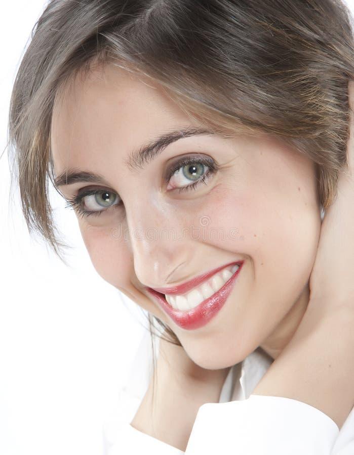 Sonrisa feliz de la mujer joven foto de archivo