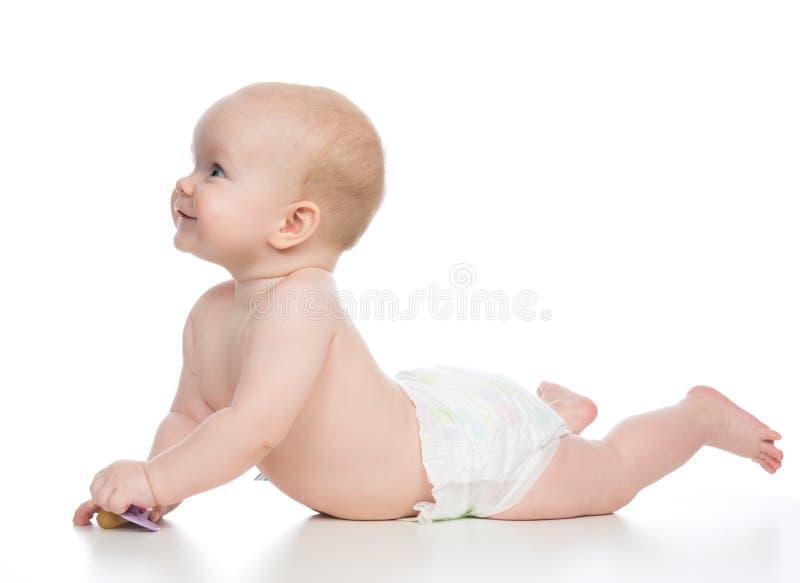 sonrisa feliz de mentira del bebé infantil del niño de 6 meses fotografía de archivo libre de regalías