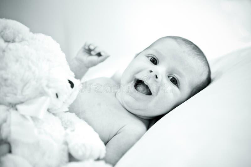 Sonrisa feliz del bebé fotografía de archivo