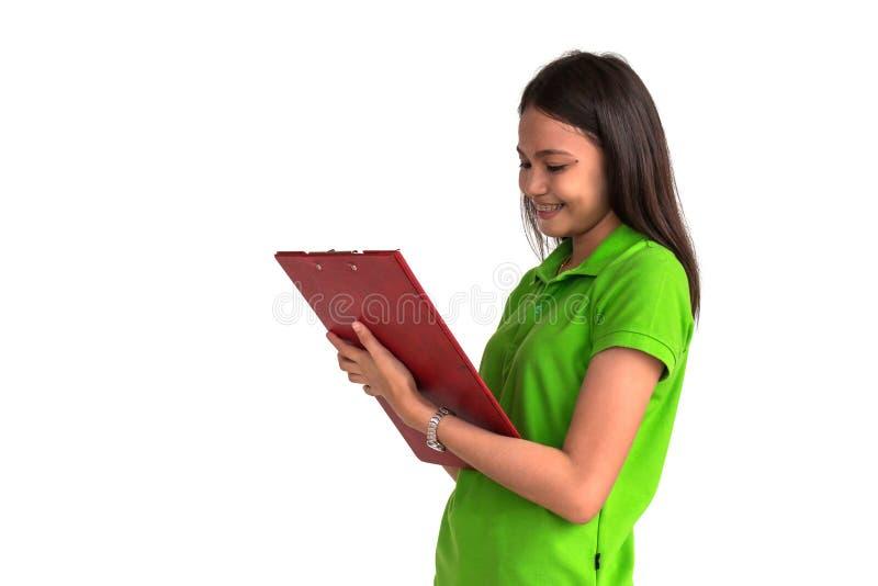 Sonrisa femenina con el tablero aislado en el backgr blanco imágenes de archivo libres de regalías