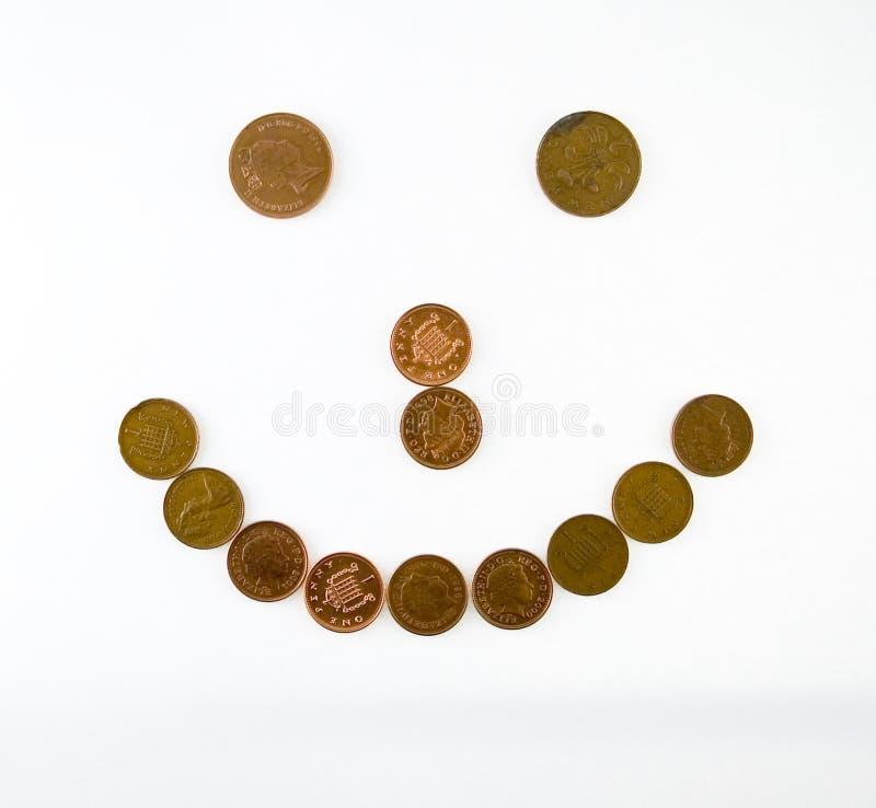 Sonrisa hecha de monedas fotos de archivo libres de regalías