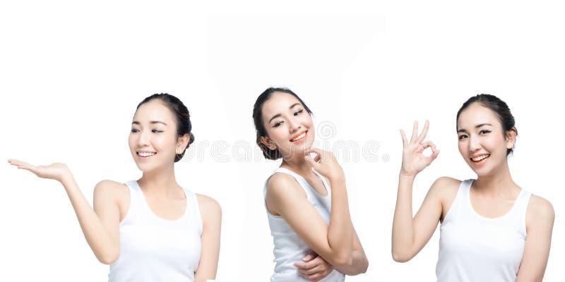 Sonrisa hermosa asiática de la mujer joven, concepto para sistema de los cosméticos de las bellezas el actual en el fondo blanco imagenes de archivo