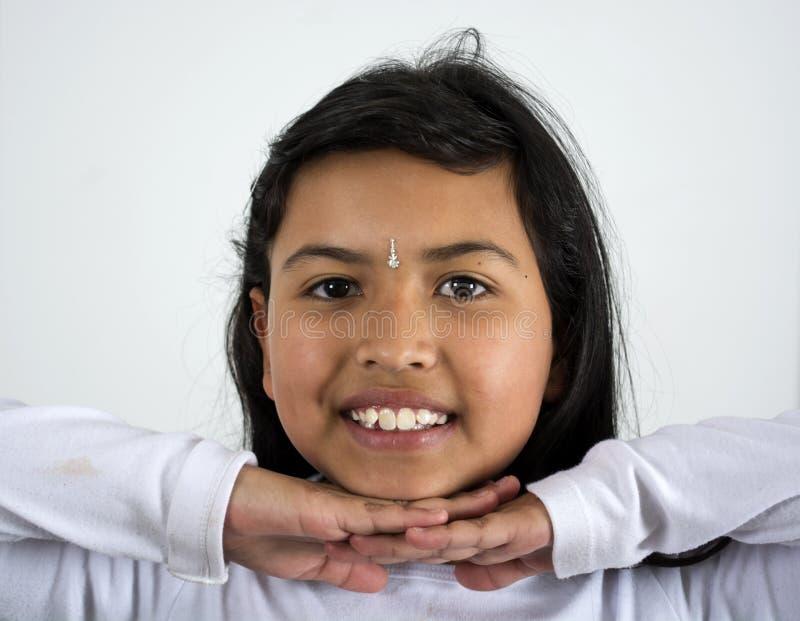 Sonrisa india de la mujer foto de archivo libre de regalías