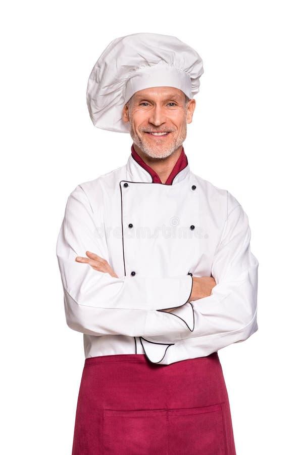 Sonrisa mayor del cocinero foto de archivo