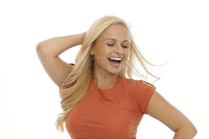 Sonrisa rubia de la mujer feliz imagen de archivo