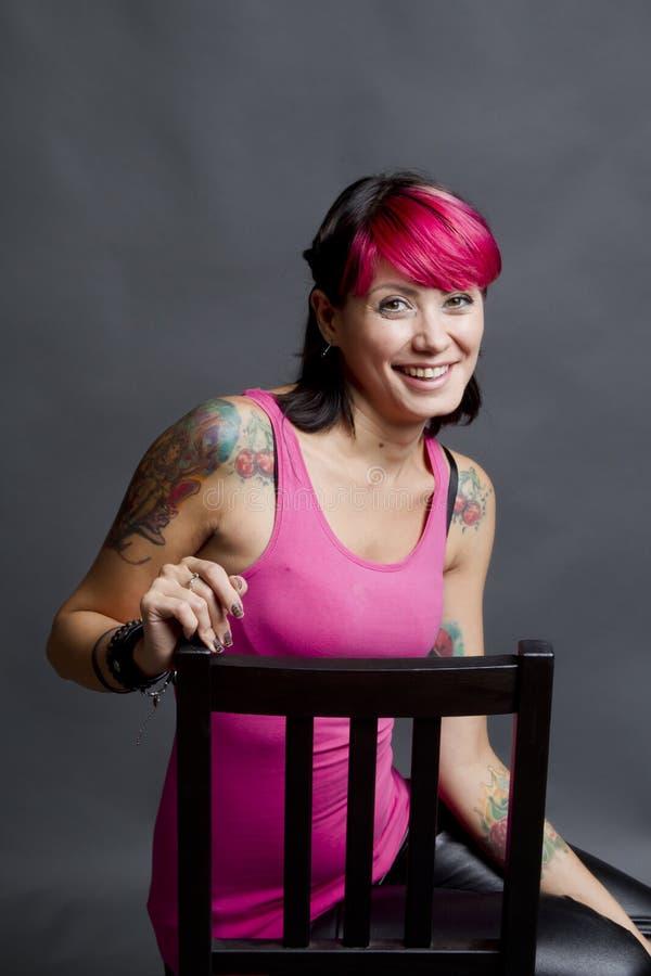 Sonrisa tatuada de la mujer imagen de archivo libre de regalías