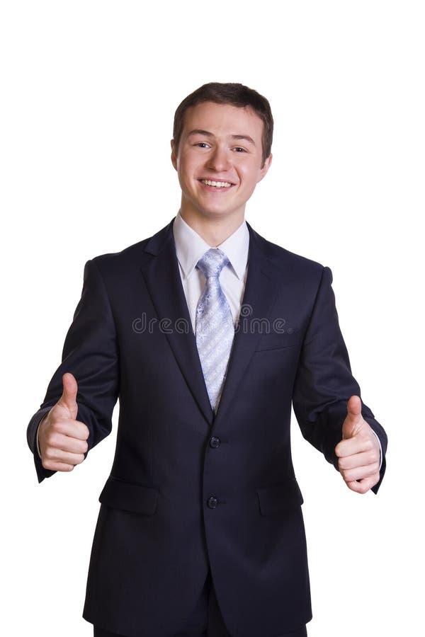 Sonrisa y demostraciones del hombre de negocios OK. fotografía de archivo