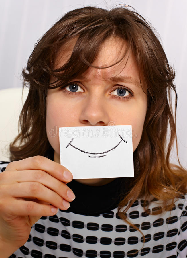 Sonrisas cansadas de la mujer al igual que fotos de archivo libres de regalías