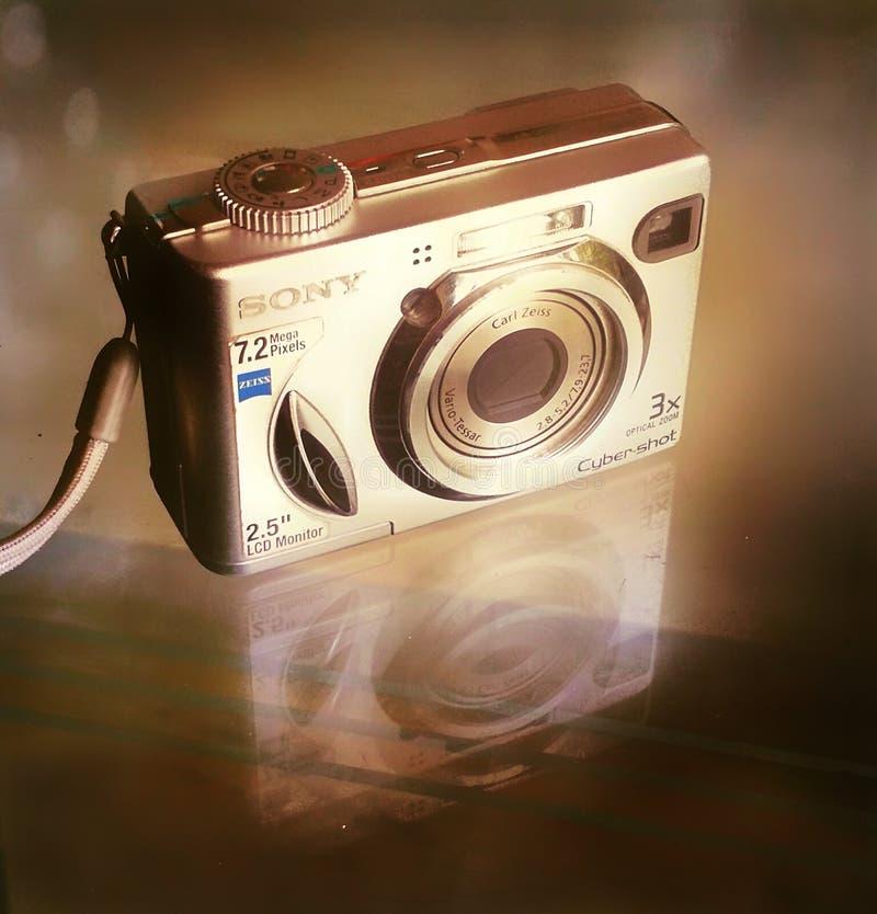Sony camera gold hue. Camcorder, lens, photos stock photos