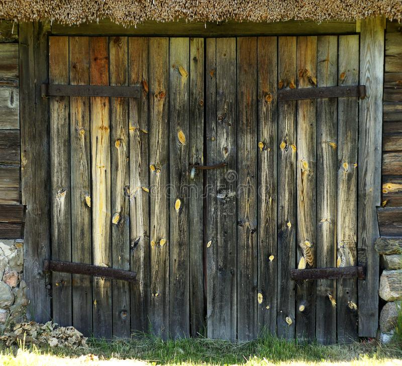 Old village traditional log house wooden closed gates, Latvia stock images