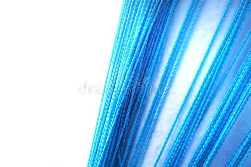 Blue room curtains hang down bright stock photo