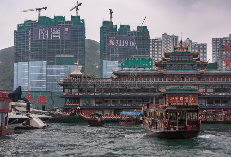 Massive Jumbo Floating Restaurant in harbor of Hong Kong, China. SONY Hong Kong, China - May 12, 2010: Massive colorful traditional architectural Jumbo Floating royalty free stock photos