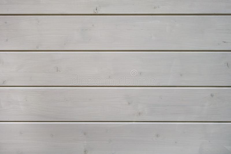 Painted white wooden panel made out of beams texture stock image