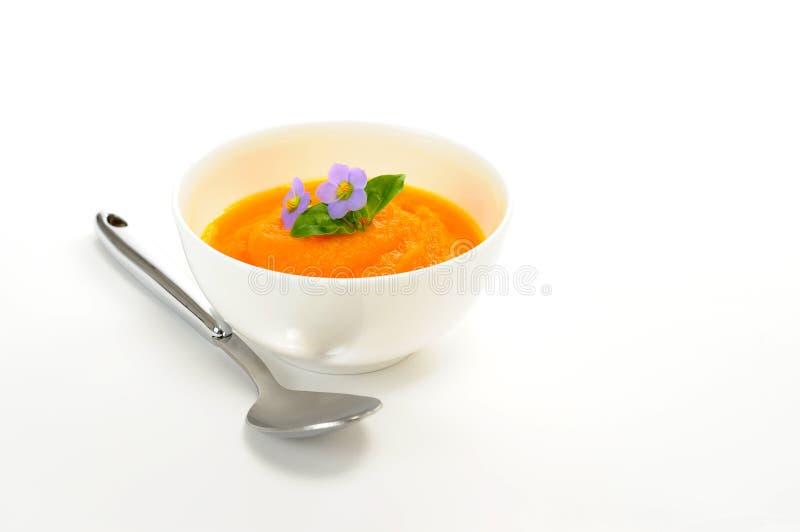 Sopa alaranjada da cenoura foto de stock royalty free