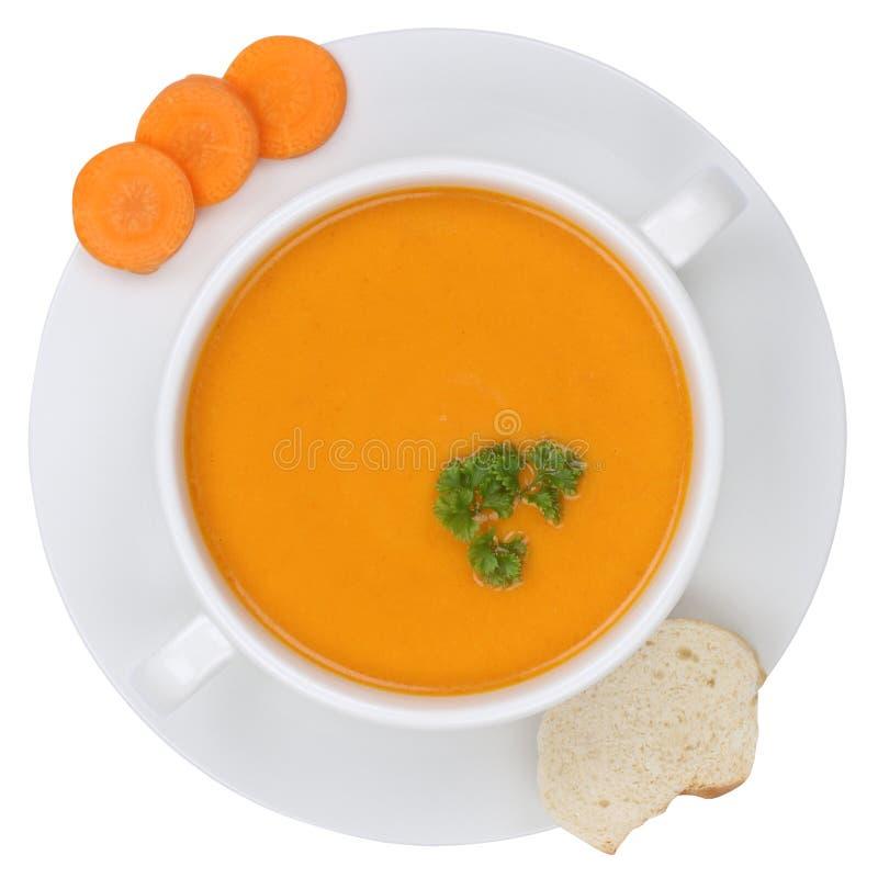Sopa de la zanahoria con las zanahorias en cuenco desde arriba de aislado imágenes de archivo libres de regalías
