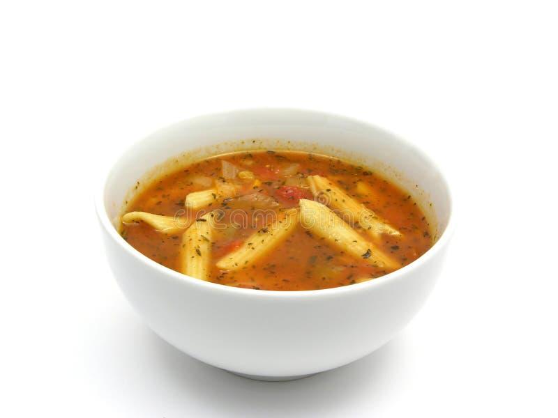 Sopa de tallarines con los tomates fotografía de archivo