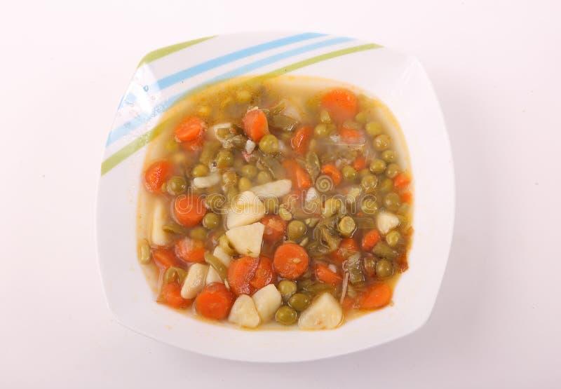 Sopa de vegetais no prato fotos de stock