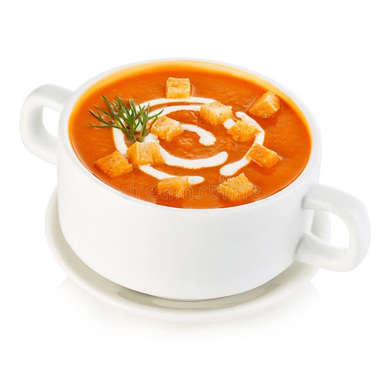 Sopa deliciosa da abóbora e da cenoura com creme de leite e close-up do pão torrado isolada em um fundo branco fotos de stock royalty free