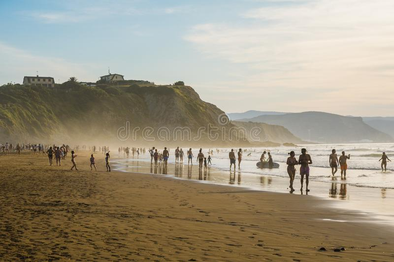Sopelana Beach, Spain - August 16 2019: People walking on the beach. Beautiful sunset in Basque Country, north of Spain. By the atlantic Ocean stock photography