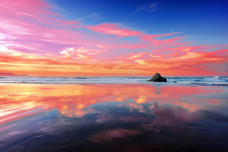 Sopelana beach at sunset with clouds reflections stock photo