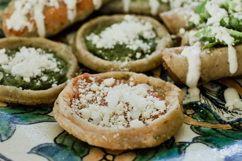 Sopes, Mexican food spicy in Mexico. Mexican Feast in a talavera plate stock photos