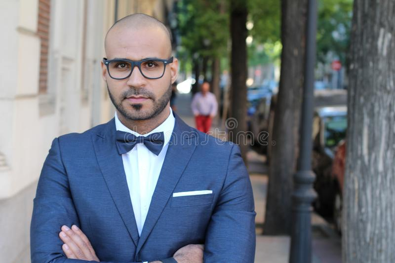 Sophisticated ethnic man looking quite posh royalty free stock images