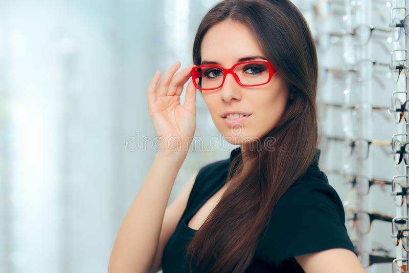 Woman Wearing Eyeglasses in Optical Store royalty free stock photography