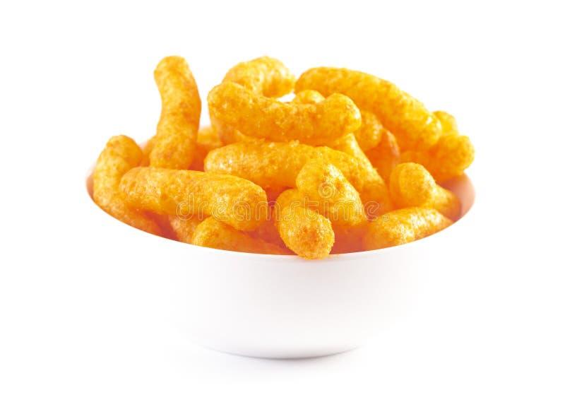 Soplos anaranjados del queso cheddar en un fondo blanco fotografía de archivo libre de regalías