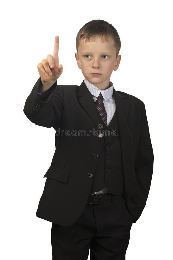 Soportes del muchacho aislados en el fondo blanco fotos de archivo libres de regalías