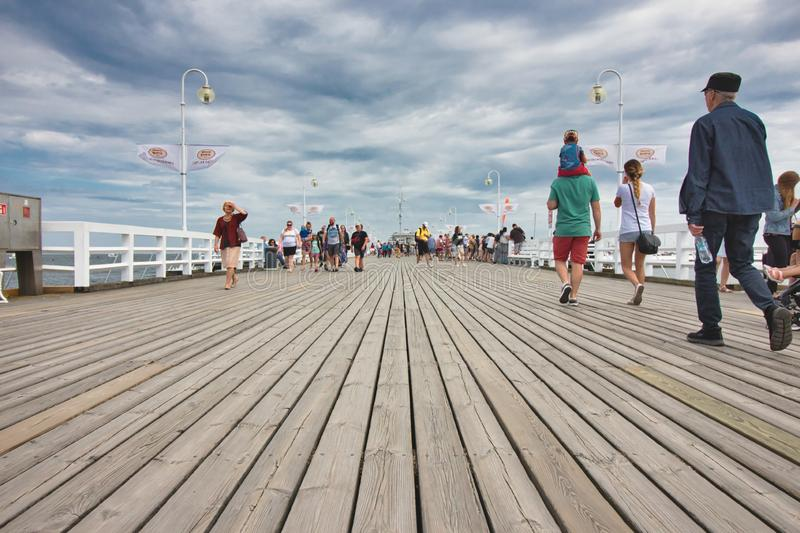 Sopot / Croatia - August 3 2019: People walking on the wooden boards of the pier at Sopot beach royalty free stock image
