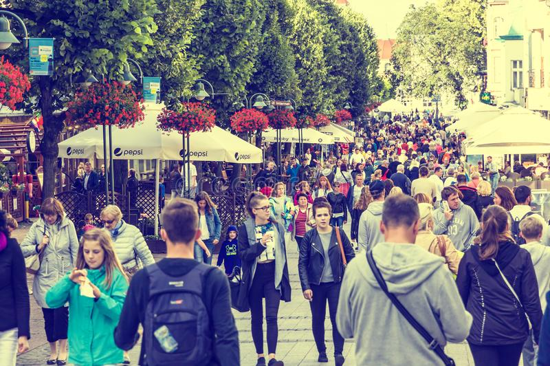 People walking on Heroes of Monte Cassino Street in Sopot, Poland stock photography