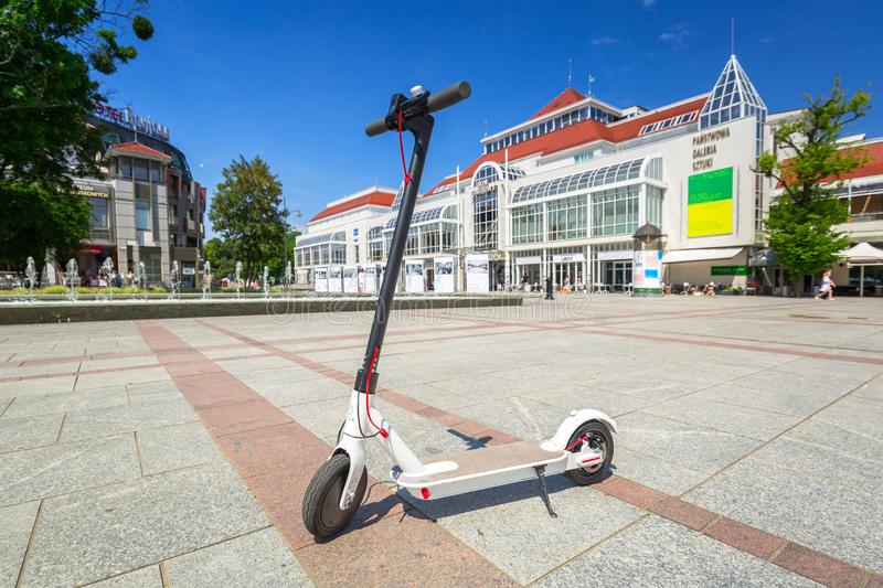 Sopot, Poland - June 19, 2019: Electric scooter for hire in Sopot, Poland. Sopot is major tourist destination in Poland with the stock images