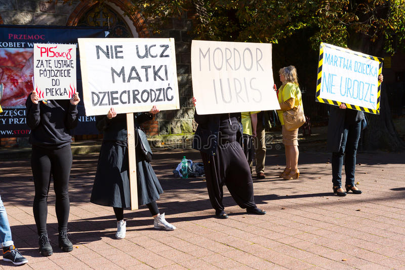 Sopot, Poland, 2016 09 24 - protest against anti-abortion law forced by Polish government. People with banners saying: people of PIS - you'll go to hell for stock photo