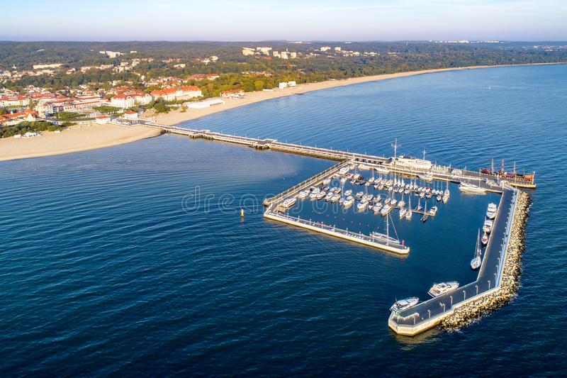 Sopot resort in Poland with pier, marina yachts and beach. Aeri. Sopot resort in Poland. Wooden pier molo with marina, yachts, beach, pirate tourist ship royalty free stock photography