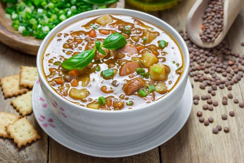 Soppa med linser och korvar royaltyfria foton