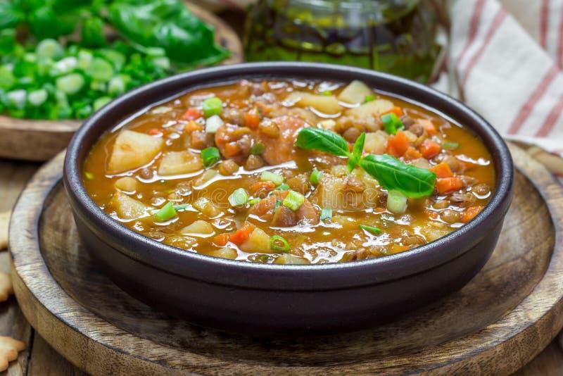 Soppa med linser och korvar royaltyfri fotografi
