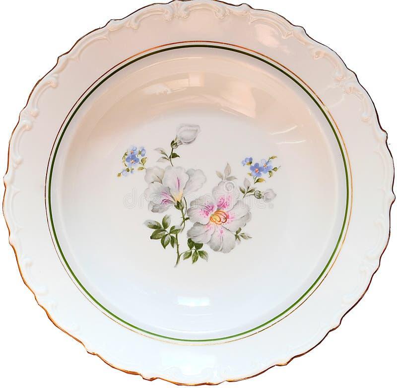Soppaplattan som göras i klassisk stil som dekoreras med lättnadsmodeller, blommamodeller av violets och glömma-mig-nots och rems royaltyfri bild