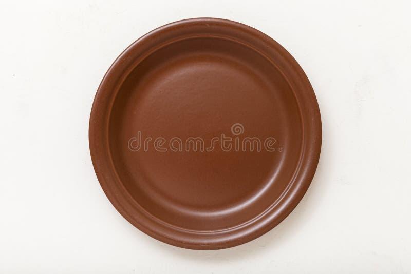 Sopra il piatto di marrone di vista sul plasterboard bianco fotografie stock libere da diritti