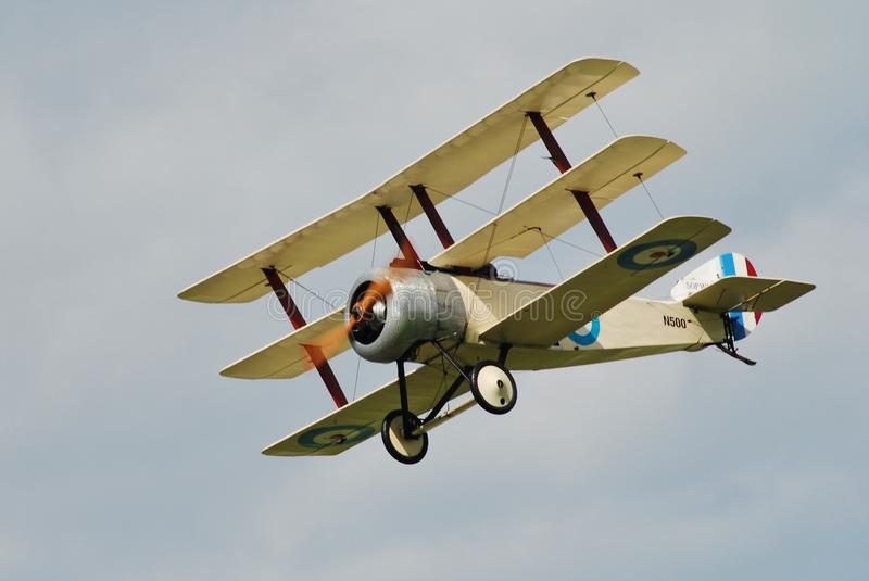 Sopwith N500 triplane. Sopwith triplane N500 of the Great War Display Team performs at the Dunsfold airshow in Surrey, England on August 23, 2014. The 1997 built royalty free stock photography