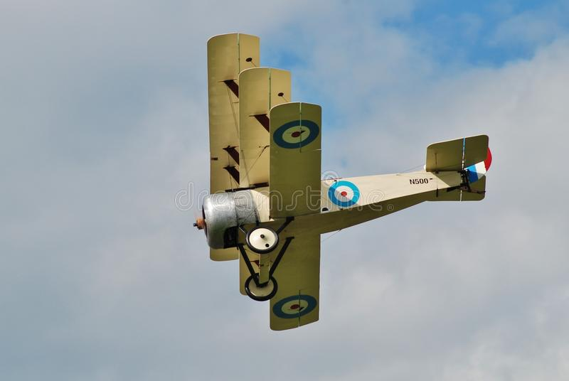 Sopwith triplane N500. Of the Great War Display Team performs at the Dunsfold airshow in Surrey, England on August 23, 2014. The 1997 built aircraft is a royalty free stock image
